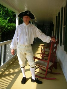 man on porch of historic home near Valley Forge